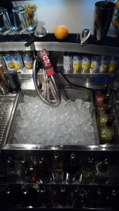 Clockwise: Jiggers, Hawthorne Strainers, Boston Shakers, More Fruit, More Juice, Real Well, Mountain of Ice, Kitchen Torch, Mixing Glasses, Straws, Picks, Fine Strainer, Bullshit Soda Gun