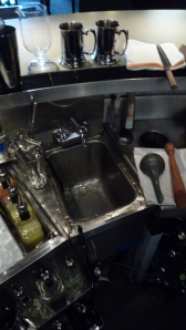 Clockwise from noon: Blu Blazer Mugs, Knife, Muddler, Juice Press, Perlage , Channel Knife, Y Peeler, Julep Strainer, Barspoons, Washing Sink, Fresh Juices, Mixing Glass